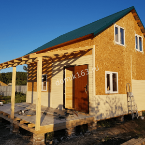Дом в Молгачах в процессе внешней отделки